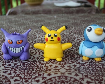 Pokemon inspired fondant characters Pikachu, Piplup, Squirtle, and Gengar