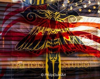 Tattoo Studio in San Francisco, California, USA, color photography, shop window reflection, american flag, vintage photos of tattooed people