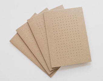 Perforated, A5 notebooks, sketchbooks, journals. Handmade out of recycled paper.