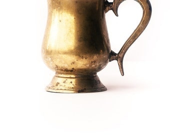 Old Antique cup made from brass