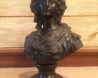 Bronze bust of womans head