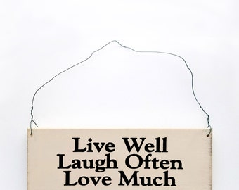 Wood Sign Saying Live Well Laugh Often Love Much.