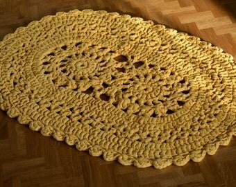 Crocheted yellow oval rug