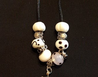 Black and white beaded owl necklace