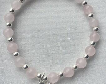 Sterling silver and rose Quartz tree of life bracelet.