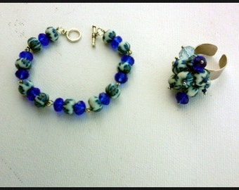 Boho Bracelet with blue facet glass beads and flower beads with same beads ring