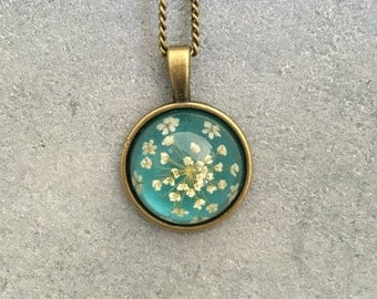 White Queen Anne's Lace against Teal Background in Dainty Cabachon Antique Bronze Bezel Resin Necklace, Resin Pendant