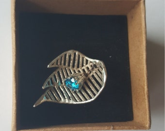 Abstract leaf 3D printed and cast pendant with blue zirconia