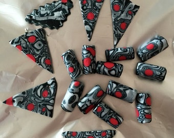 11 oblong beads from Fimo, Mokume-Gane-style, red, black, silver