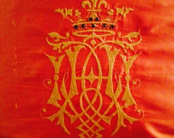 Orange silk embroidered crown pillow with rhinestone embelishment