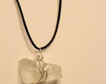 Thick White Oblong Sea Glass Pendant With Nylon Overhead String. No. 111. About 20 inches long.
