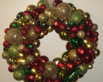 Elegant red, green and gold ornament wreath.  ID number 469480354