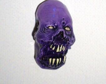 Purple Flesh Eater Zombie Head Pendant