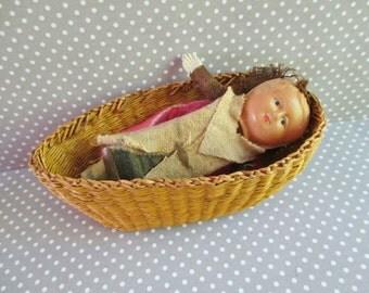 Little Vintage Celluloid Doll in Straw Basket