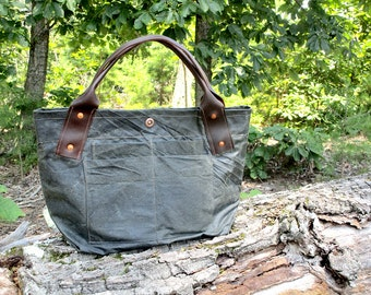 Recycled & waxed army tent canvas handbag. Leather handles and pockets galore! Upcycled, local,and handmade.