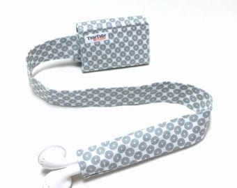 Gray circles TuneTube.  Earbud cord organizer for iPhone or iPod.  Cord keeper.  Earbud holder.  Earbud case.