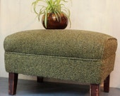 vintage mid century ottoman with green upholstery