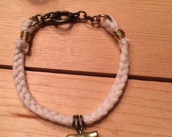 braided cotton bracelet with gold bird charm