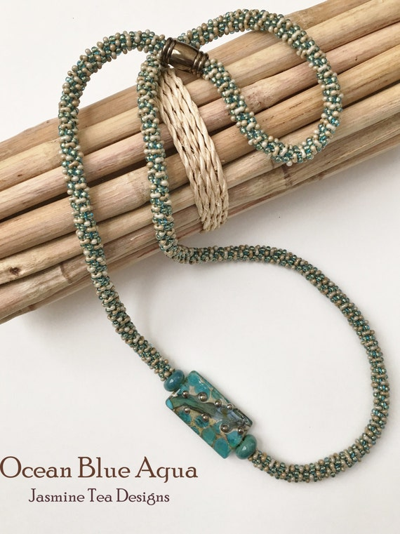 Ocean Blue Aqua Beaded Kumihimo Necklace, Asymmetric Necklace with Artisan Lampwork Focal Bead