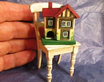 From *DJD* Tiny ,vintage Tri-ang  inspired,,dollhouse for a dollhouse toy and tatty chair.
