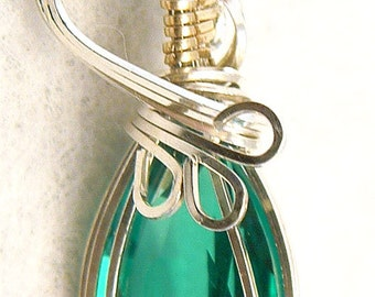 Emerald pendant wire wrapped in silver jewelry