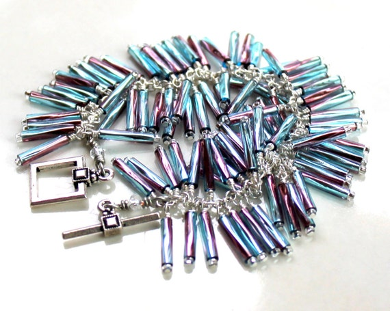 industrial shimmer. edgy bracelet. wire wrapped blue/purple bugle beads. beaded handmade jewelry. square clasp.