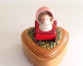 Vintage Heart shaped Wooden Box with A Tiny Baby in a Carriage