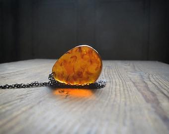 Huge fiery Amber pendant Misty cognac orange amber Drop on gunmetal chain Talisman Necklace