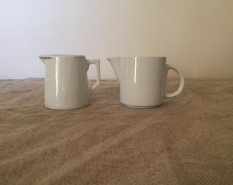 Two vintage white milk jugs. My vintage home / white decor.