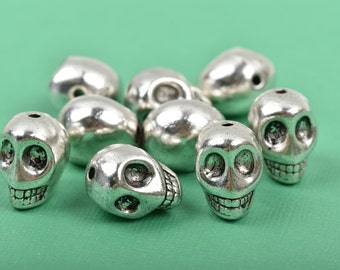 5 Silver Metal SKULL Beads, drilled top to bottom, 18mm, bme0399