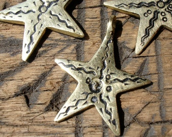 Moroccan hand engraved brass star pendant with wavy lines design