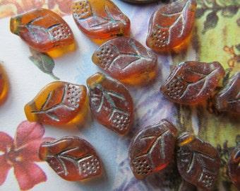 20 Small Vintage Topaz  Glass Pressed Leaf Bead