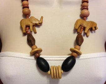 Vintage Hand Carved Elephant and Lion Wood Bead Necklace 26.25 Inches Long In Various Shades of Brown Wood Previously 30 Dollars ON SALE