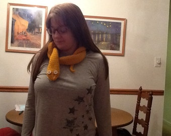 Snake scarf in golden yellow