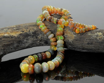 48.85ct Fire Play Natural Ethiopian Welo Opal Round Beads 32 cm Strand