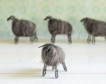 Wired lamb with dark wool