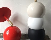 Newt.  Wall sconce lamp light. White black red tan Solid metal shade tilting brass light with bulb UL LISTED