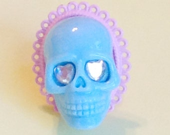 Pastel Blue Skull Ring with Heart Rhinestone Eyes on Pink Cameo Base