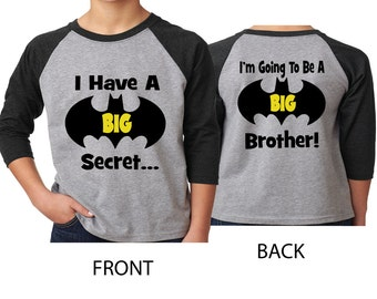 I have a Big Secret I'm Going to Be A Big Brother  on a Gray and Black Raglan Shirt