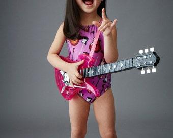 ELECTRIC GUITARS: Girls purple tank swimsuit
