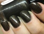 Furiosa Nail Polish - blackish brown with smokey metal flakes
