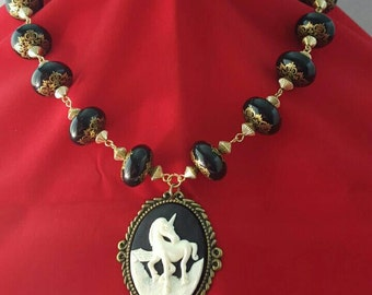 Black and gold Filigree Beaded Necklace with Unicorn Cameo