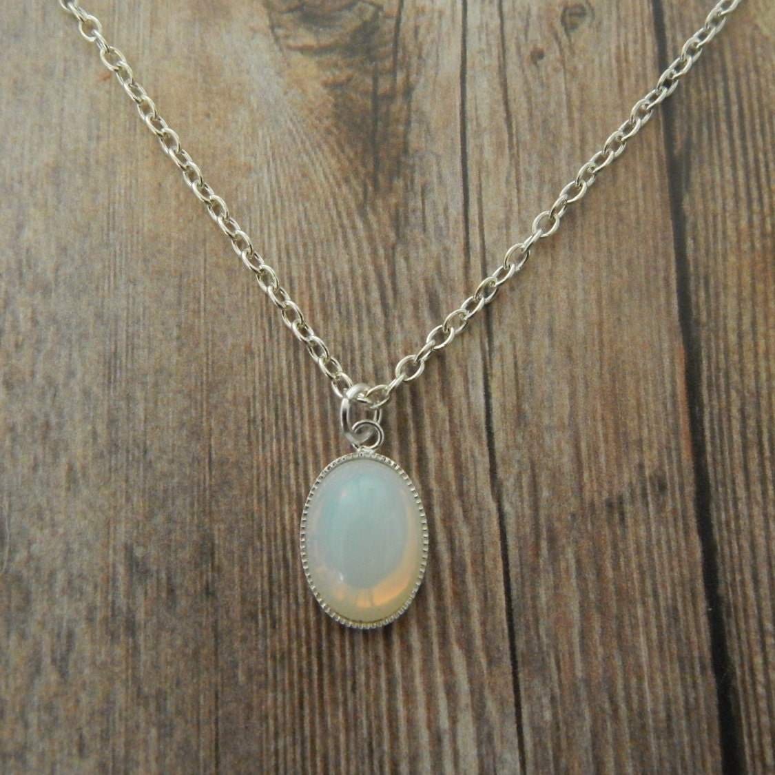 White Opal Necklace Opal Pendant Silver White Opal. Blue Crystal Pendant. Cool Watches. Dainty Necklace. Mine Cut Diamond Engagement Rings. Mixed Metal Engagement Rings. Track Watches. Large Gold Earrings. Crystal Beads For Jewelry