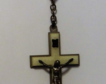 Christain Cross each bead glows in the dark, it is complete