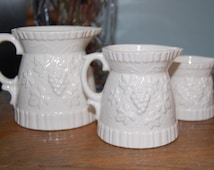 Three Ceramic Measuring Pitchers / 8 Oz. 4 Oz. 2 Oz. / Grapevine Decorated