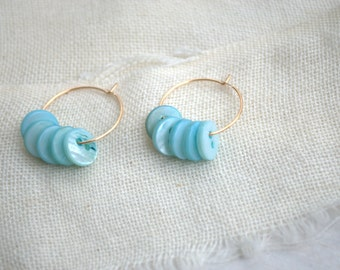 Gold hoop earrings with turquoise mother of Pearl buttons