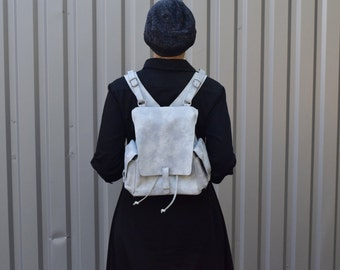 little off-white & blue leather backpack with side pockets