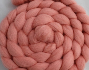 2 oz braid of Ashland Bay Salmon Merino Combed Top (roving).  Great for Spinning and Felting