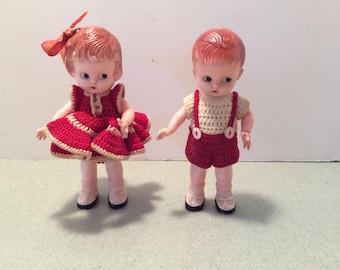 Vintage Dolls by Knickerbocker Plastic Co.  Boy and Girl Dolls. rattle Dolls.