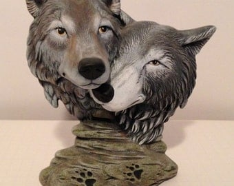 Two wolf heads on rock